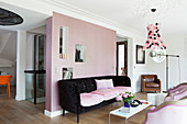 Pink partition wall with niches in living room