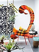 Artistically curved outdoor easy chair with ethnic striped pattern
