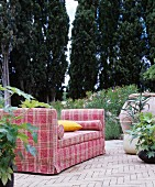 Tartan sofa on Mediterranean terrace