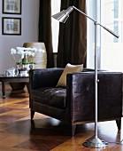 Standard lamp next to dark brown leather armchair