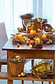 Small wreaths of wild flowers festively arranged on table with gold baubles and candles