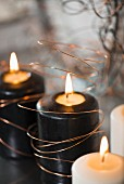 Black candles wrapped in copper wire