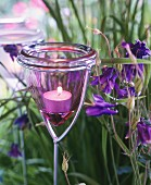 Decorative garden stakes with glass tealight holders on top