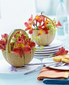 Flowers in baskets carved from melons as table centrepieces