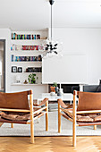Scandinavian chairs with leather seats and backs in living room