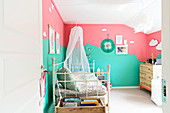 Child's bedroom with bicoloured walls in mint and pink