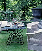 Set table in summery seating area in garden