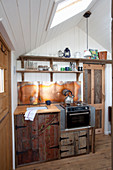 Kitchenette made from reclaimed wood in tiny house