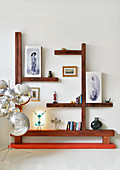 Ornaments on angular shelving made from wooden beams