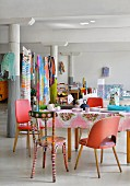 Columns and colourful eclectic furnishing in loft apartment