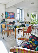 Tables and various chairs in artistic loft apartment
