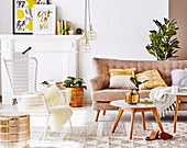 Sofa, coffee table and outdoor chair in the living room with gold-colored accessories
