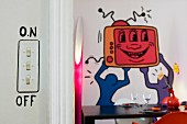 Light switch with comic-style border and pop-art mural