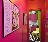View along hallway with hot-pink walls into kitchen with painted floor