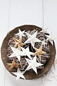 Folded white and brown paper stars on wreath