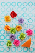 Paper roses on paper with pattern of hand-stamped circles
