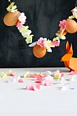 Garland of threaded paper flowers and eggs