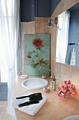 Floral artwork on washstand in classic bathroom