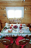 Festively set table in rustic wooden cabin