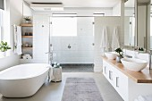 Free-standing bathtub in large bright bathroom