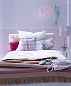 Various patterns in shades of pink in romantic bedroom