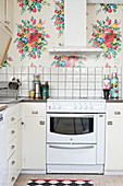 Old kitchen with floral wallpaper