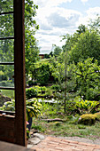 View of pond in garden from orangery