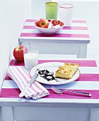 Breakfast arranges on stools with pink-striped tops used as children's tables
