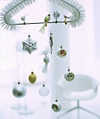 Christmas-tree baubles and birds hung from triangular brush head