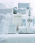 Wrapped gifts and Christmas-tree decorations in white and silver