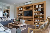 Open shelving with integrated TV in living area