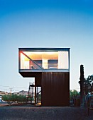 Cubist house with glass wall and exterior staircase