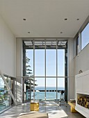 Modern, experimental beach-house with panoramic window and sea view