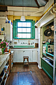 Rustic kitchen with a green color accent