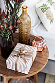 Wrapped gift on the bedside table with decoration in earth tones