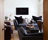 Dark upholstered furniture and TV in living room
