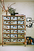 Rollable shelf with vintage metal boxes