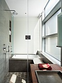 Shower and fitted bathtub in modern bathroom