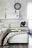 White leather sofa combination and vases hand-made from cans on ottoman
