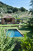 Pool and roofed terrace in Mediterranean garden