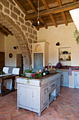 Herringbone brick floor in Mediterranean country-house kitchen