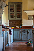 Distressed, blue wooden units in Mediterranean country-house kitchen