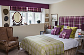 Tartan textiles in English-style bedroom