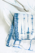 Napkin hand-dyed using Shibori technique