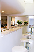 White open-plan kitchen in modern architect-designed house