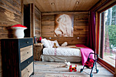 Picture of polar bear in child's bedroom with wooden walls