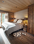 Rustic bedroom in shades of brown with wooden floor