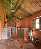 Mediterranean kitchen with terracotta tiles and fireplace