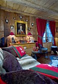 Gemütliches Wohnzimmer im Chalet mit Gemälde und Trophäen