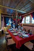 Elegantly set, Alpine-style Christmas dining table